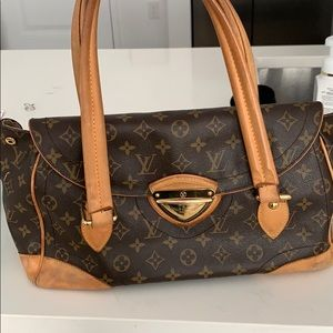 Louie Vuitton satchel bag